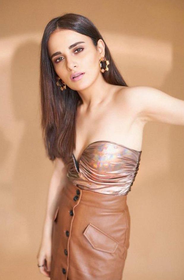 Radhika Madan looks scintillating in metallic strapless top and brown asymmetrical mini skirt