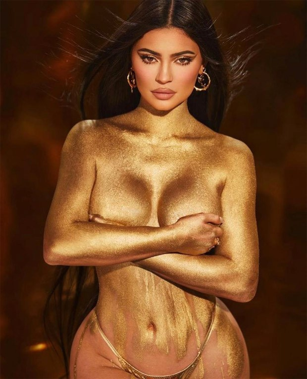 Kylie Jenners goes topless with shimmery body paint to promote her birthday make up collection
