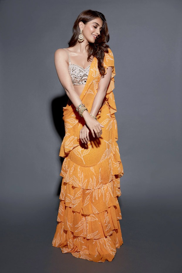 Pooja Hegde is a stunner in a bright orange outfit from Arpita Mehta worth Rs. 48000