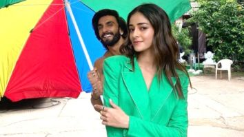 Ranveer Singh holds umbrealla for Ananya Panday as she poses in a stunning green blazer set